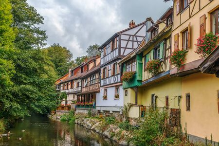 Historic houses on the embankment of Weiss river in Kaysersberg, Alsace, France Stock Photo