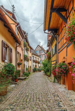 Picturesque historical street in Eguisheim, Alsace, France