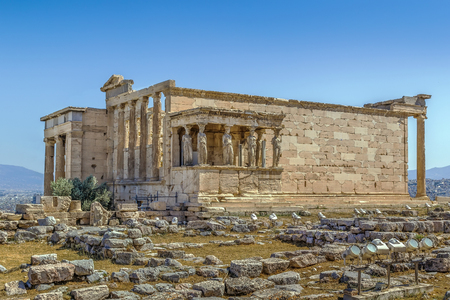 The Erechtheion is an ancient Greek temple on the north side of the Acropolis of Athens in Greece which was dedicated to both Athena and Poseidon. Stock Photo