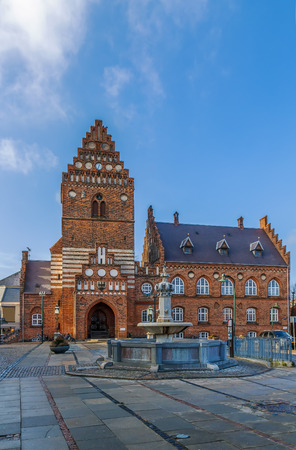Town hal in Roskilde is 19th century building in Neo-gothic style. The Gothic tower, the only remain of the St. Lawrence church, built in the early 12th century and destroyed during the Reformation.