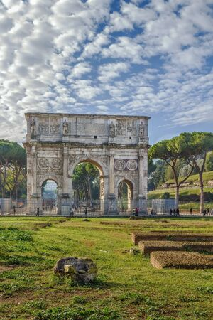 The Arch of Constantine is a triumphal arch in Rome, situated between the Colosseum and the Palatine Hill, Italy