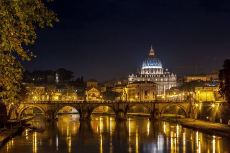 view of Ponte Vittorio Emanuele II and St. Peters Basilica in evening, Rome