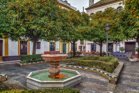 Small square with a fountain in the historic center of Seville, Spain Stock Photo