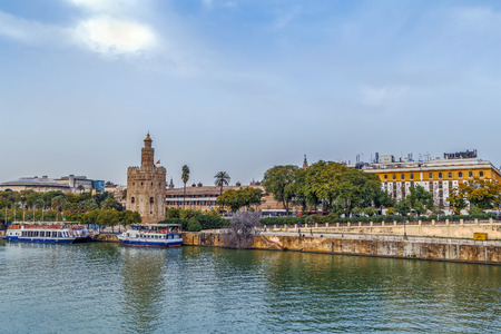 The embankment of the Guadalquivir river in Seville with Torre del Oro, Spain Stock Photo