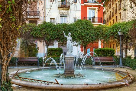 Small garden with fountain on Plaza de Joan de Vila-rasa in Valencia, Spain Banco de Imagens