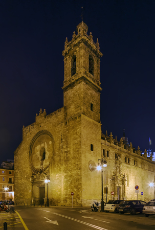 Church Santos Juanes, Valencia, Spain. Main facade with portal in evening.