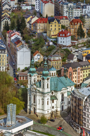 heart very: The Roman Catholic Cathedral of St. Mary Magdalene is located in the very heart of the Karlovy Vary spa area. View from hill