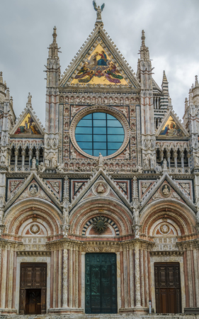 Main facade of Siena Cathedral (Duomo di Siena) is a medieval church in Siena, Italy. The cathedral itself was originally designed and completed between 1215 and 1263.