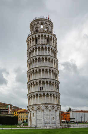 The bell tower, commonly known as the Leaning Tower of Pisa, is located on Piazza dei Miracoli in Pisa, Italy