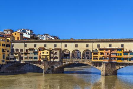 river arno: The Ponte Vecchio (Old Bridge) is a Medieval stone closed-spandrel segmental arch bridge over the Arno River in Florence, Italy