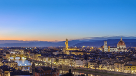 Panoramic view of Florence with Ponte Vecchio in evening from Michelangelo hill, Italy