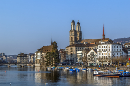 View of embankment of Limmat river with Grossmunster church, Zurich, Switzerland