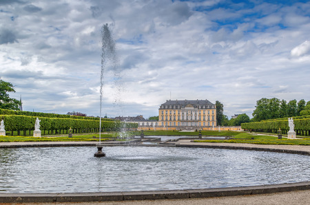 View of Augustusburg Palace with fountain and  flower garden, Bruhl, Germany