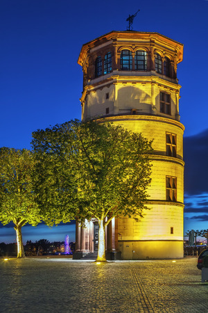 The old castle tower is the last remaining structure of the old palace of Dusseldorf which was destroyed by fire in 1882, Germany. Evening