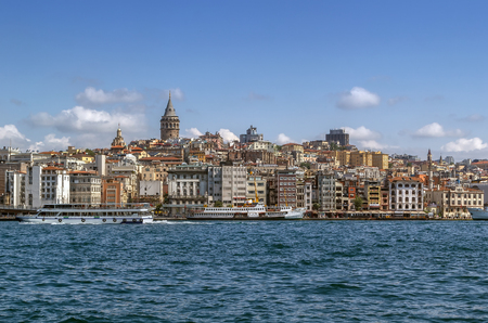 View of  Istanbul Beyoglu area with  Galata Tower from Bosphorus, Turkey  Stock Photo