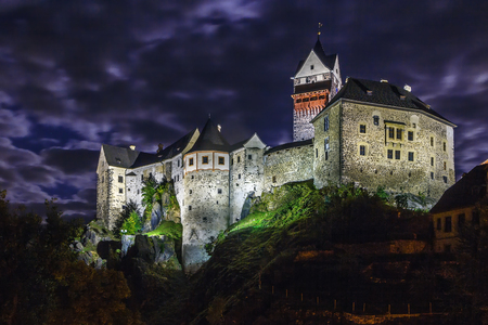 Loket Castle is a 12th-century Gothic style castle located about 12 km from Karlovy Vary on a massive rock in the town of Loket, Czech Republic. Evening Editorial