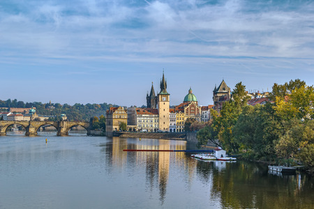 View of Vltava river with Old Town Water Tower and Charles Bridge, Prague