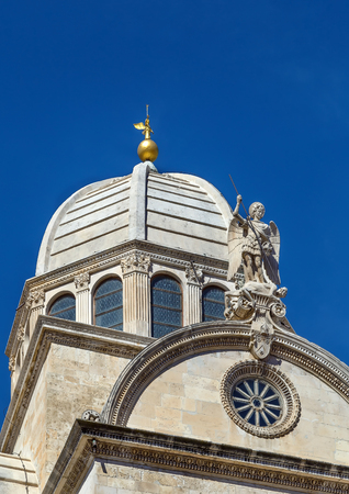 Cathedral of St. James is a triple-nave basilica in the city of Sibenik, Croatia. Dome of the cathedral and sculpture of St. Michael