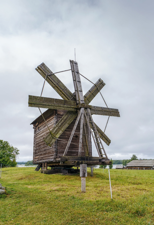 Historical site dating from the 17th century on Kizhi island, Russia. Windmill with Bikanina Stock Photo