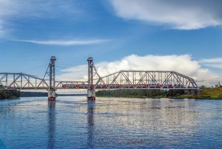 Kuzminsky Bridge is a railroad drawbridge of a vertical-climbing type across the Neva River, Russia