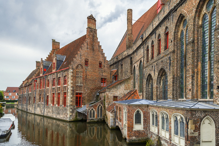 View of Old St. John Hospital from canal in Bruges, Belgium