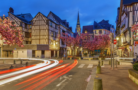Street in historical center of Rouen with half-timbered houses in evening, France.