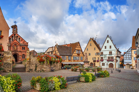 Main square with fountain with statue of pope Leo IX in Eguisheim, Alsace, France