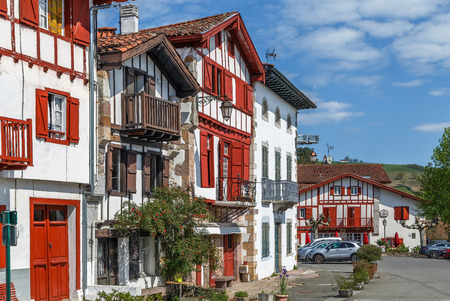 Street with historical houses in Ainhoa, Pyrenees-Atlantiques, France Standard-Bild