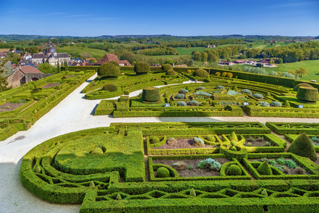 Chateau de Hautefort, France. View of the castle garden and surroundings
