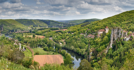 Panoramic landscape with Valley of Lot river and Saint-Cirq-Lapopie village, France