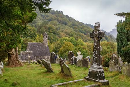 Celtic cross in a graveyard in Glendalough, Ireland