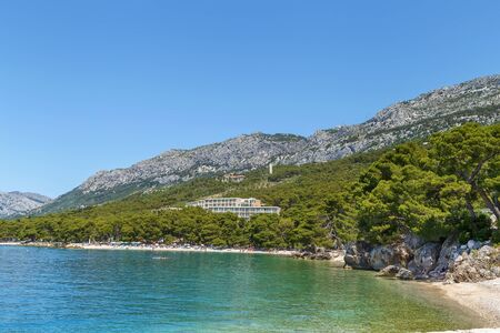 View of the shore of the Adriatic Sea with mountains in the background in the district of Brela, Croatia