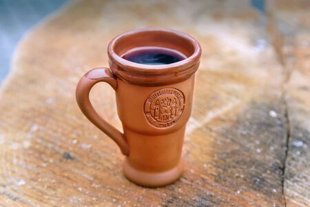 Clay mug with mulled wine at the christmas market in Munich, Germany