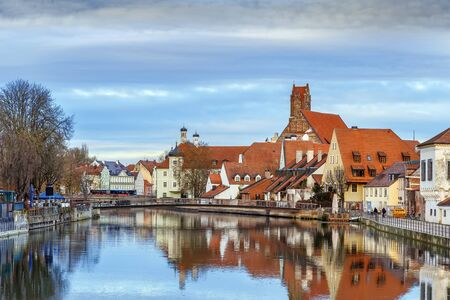 View of Isar river with Church of the Holy Spirit in Landshut, Germany