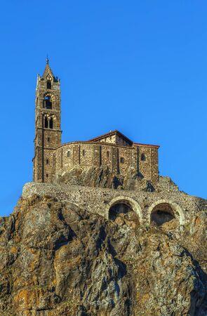 Saint-Michel dAiguilhe (St. Michael of the Needle) is a chapel on the rock in Le Puy-en-Velay, France.