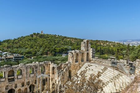 The Odeon of Herodes Atticus is a stone theatre structure located on the southwest slope of the Acropolis of Athens, Greece Stock Photo