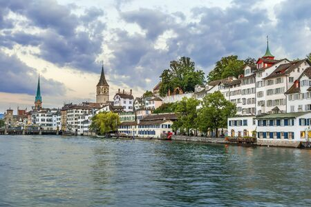 View of embankment of Limmat river with historic houses in Zurich, Switzerland