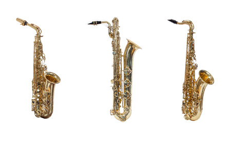 wind instruments saxophones Alto, tenor, baritone isolated against a white background