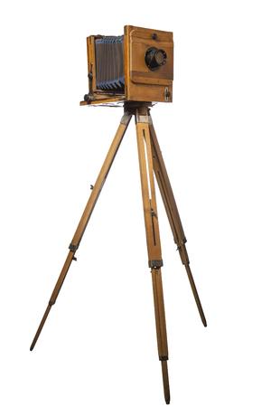 vintage photo camera on tripod isolated on white background