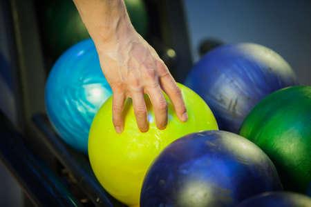 picks: hand picks a bowling ball