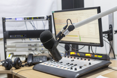 radio microphone on the background of the computer and equalizer closeup Stock Photo