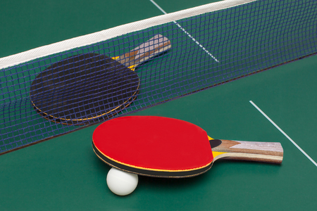 two table tennis racket red and black on a green table Stock fotó