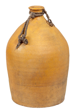 clay jug designed to store wine and other beverages isolated on a white background isolated