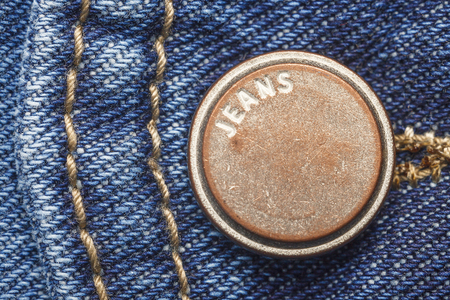 metal button on jeans close-up, blue jeans, texture