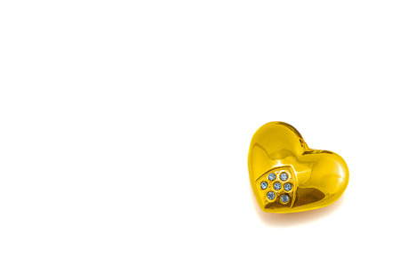 Valentine heart of gold with precious stones isolated on white background