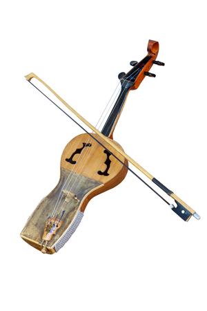 Kazakh folk musical instrument kobyz, prima with bow isolated on white background Stock Photo