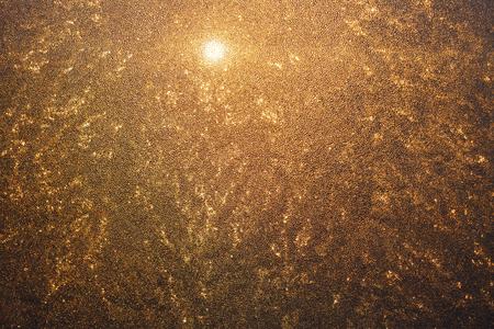 the texture of the frozen window orange translucent sunlight