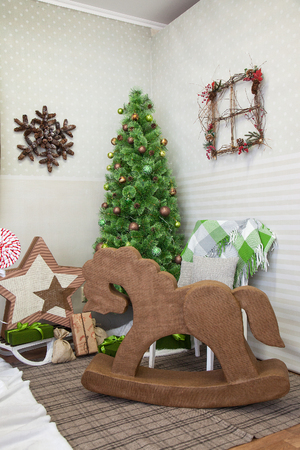 children's horse on a background of Christmas tree