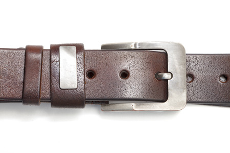 leather strap with metal buckle close - up isolated on white background Stock Photo