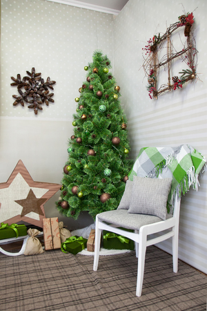 Christmas Tree In The Corner Of The Room And The Chair